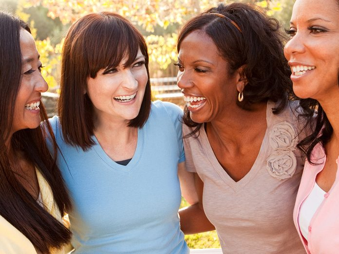 Aging, Group of middle aged women laughing