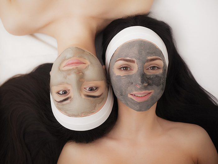 Blackheads, two women laying side by side wearing clay masks