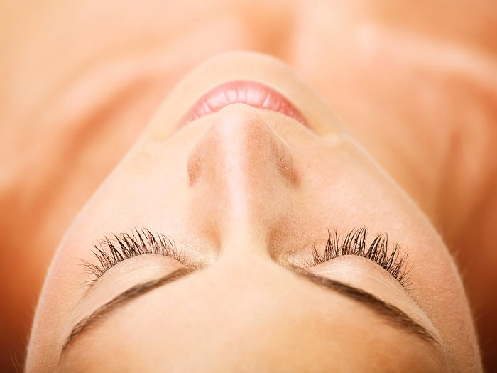 Blackheads, woman lying down, overhead shot of her face