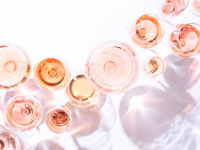 Many glasses of pink wine