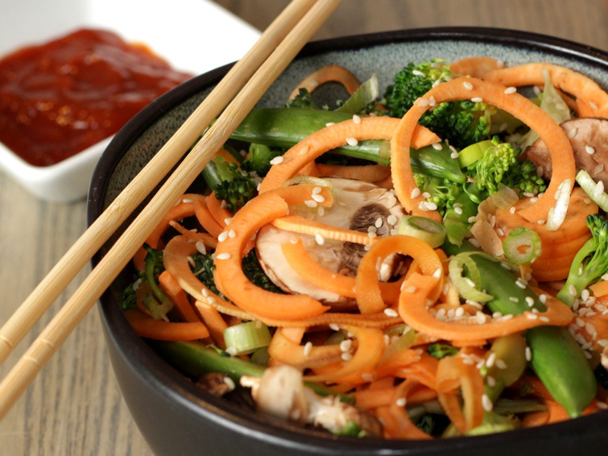 Sweet potato noodle stir-fry in bowl with chopsticks