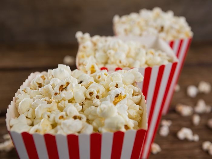 Healthy snacks, popcorn in red and white striped cartons