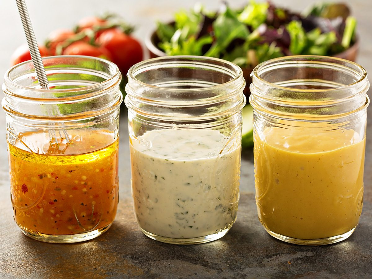 How to eat healthy, three open mason jars filled with various dressings and sauces