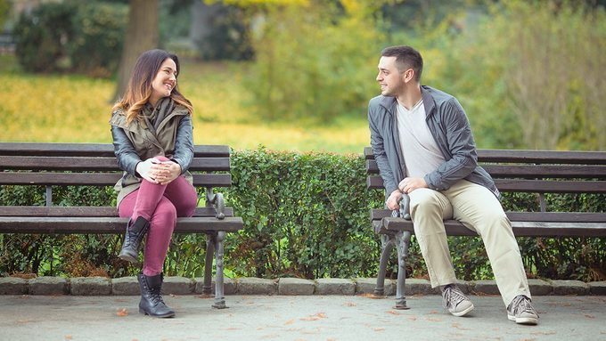 Love at first sight, man and woman on park bench