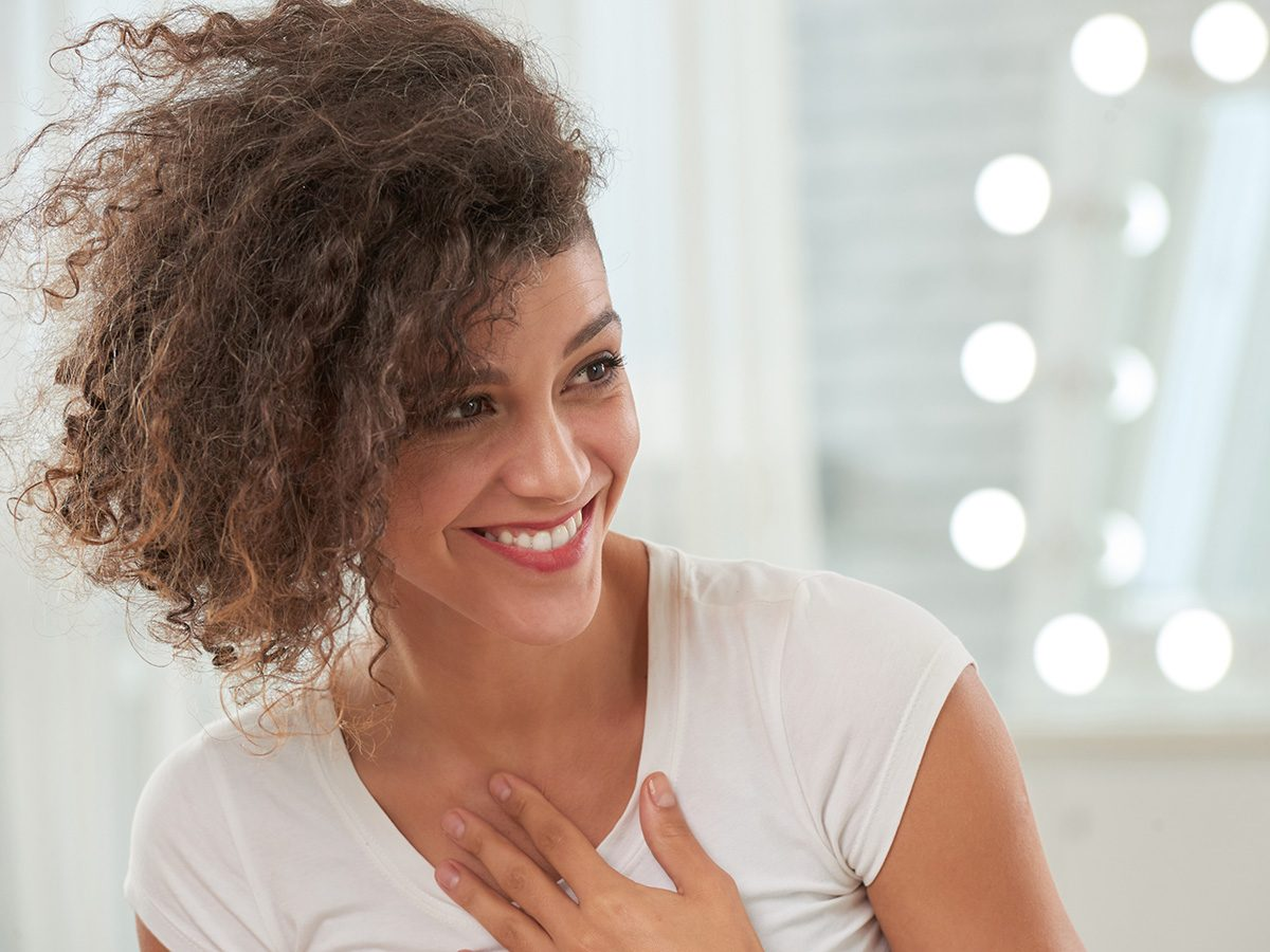 Self love, woman smiles and accepts compliment