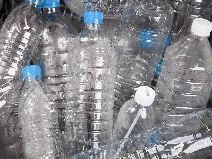 Cancer, empty plastic water bottles in a heap