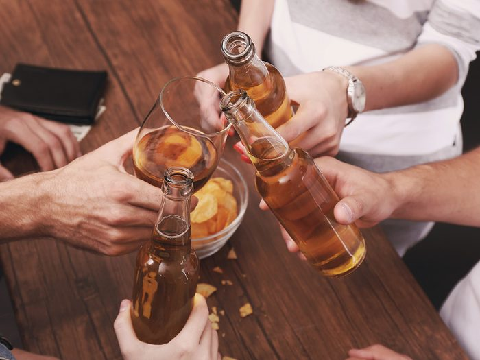 Extreme weight loss, friends drink beer at a bar and cheers