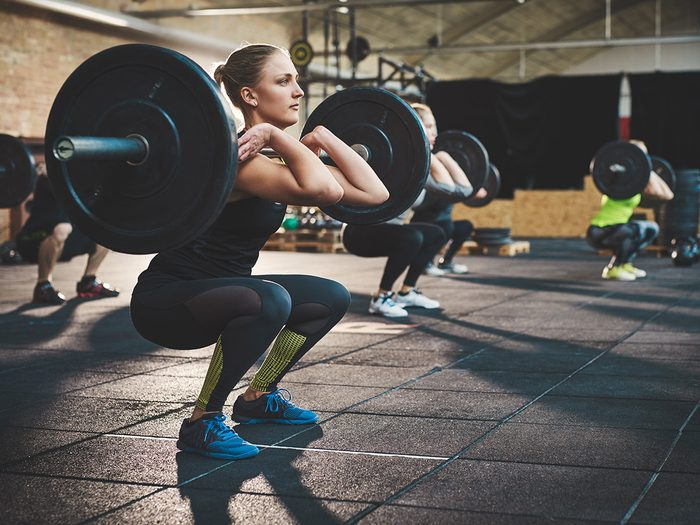 Extreme weight loss, woman powerlifting at the gym