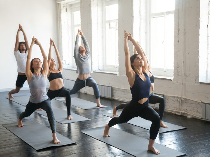 Extreme weight loss, group of people practicing yoga in a studio