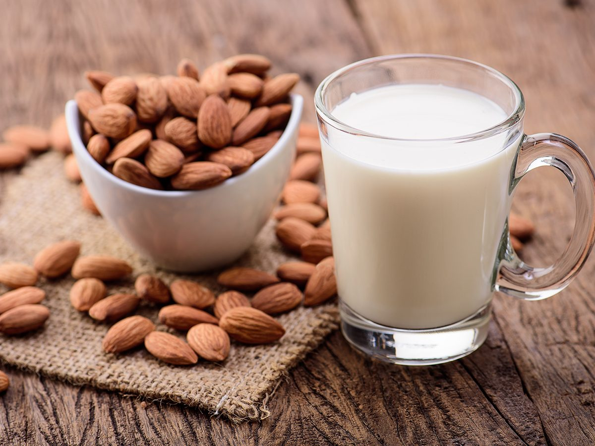 Healthy foods, a mug of almond milk next to a bowl of almonds