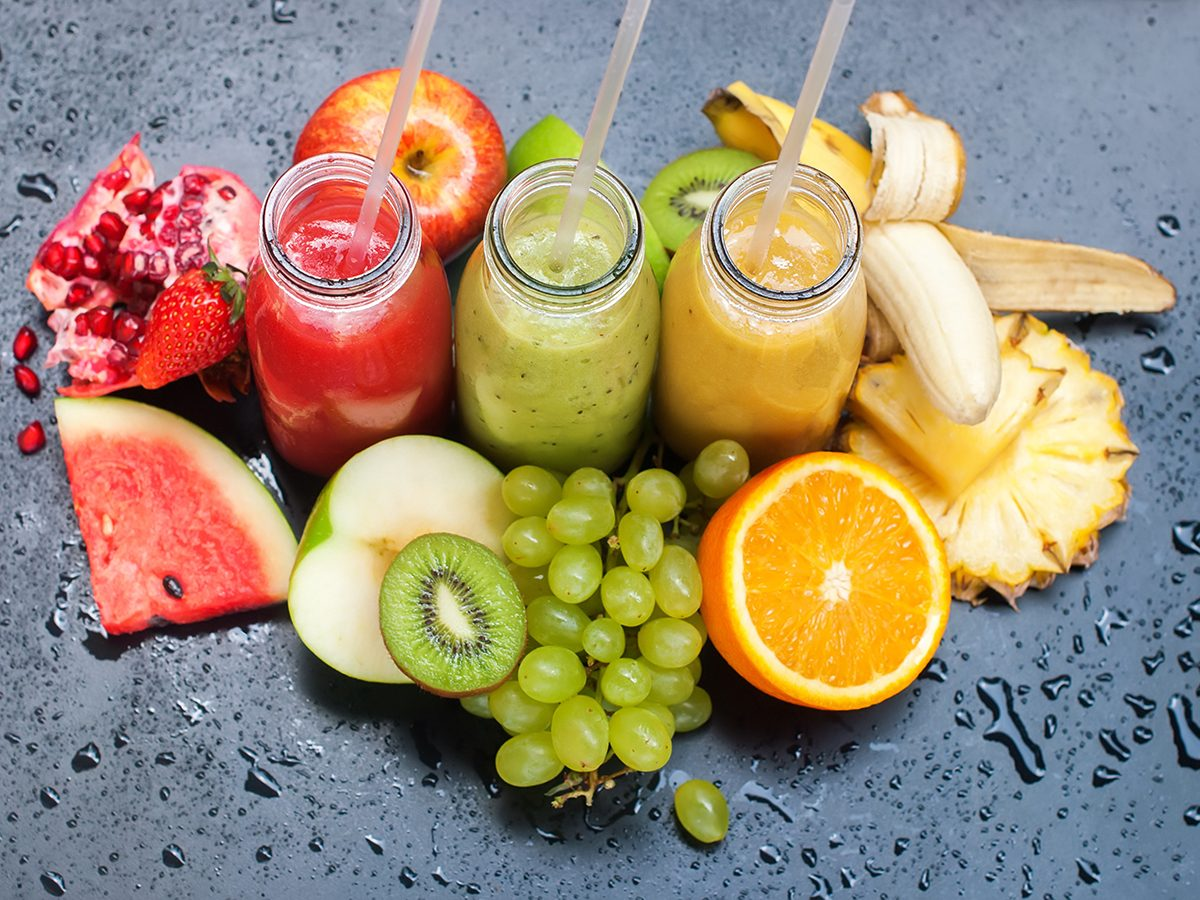 Healthy foods, cups of juice surrounded by fruit