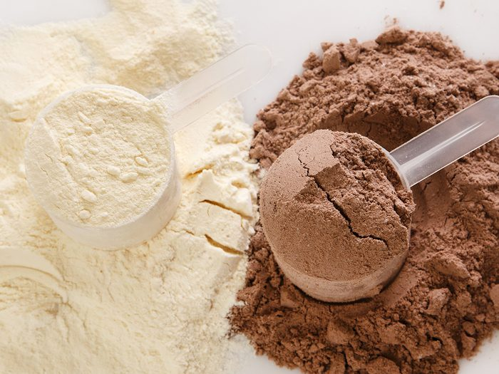 Healthy foods, scoops of vanilla and chocolate protein powder