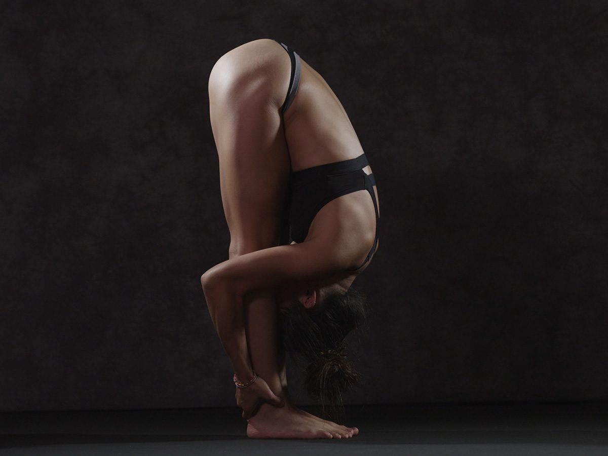 Shortness of breath, woman does a forward bend
