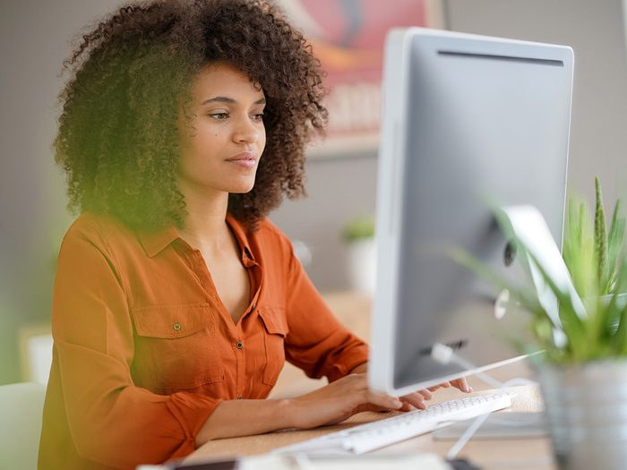 Shortness of breath, woman with good posture sits at a computer