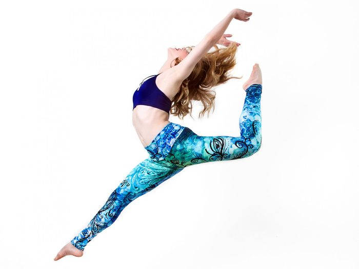 Workout gear, woman leaping in the air wearing yoga leggings from Kristina Benson Art