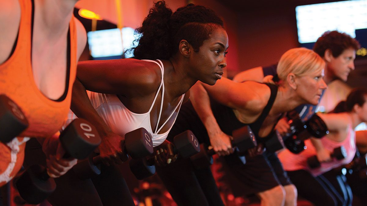 Best Fitness Studios, woman lifting weights