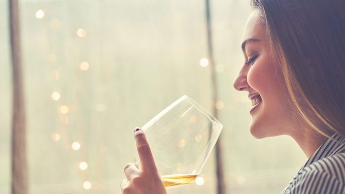 Energy, woman drinking a glass of wine