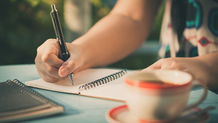 Happy People, writing in journal