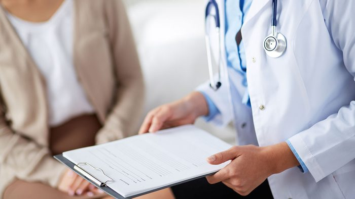 Heart Disease, woman getting checked at doctors