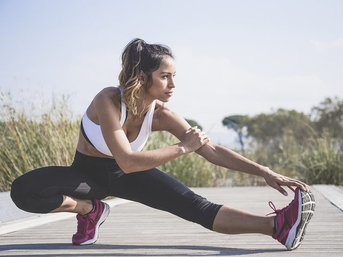 Woman stretching before an outdoor run