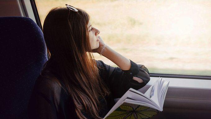 Medcan, woman sitting on train