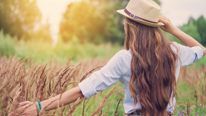 woman outside in nature healthy carefree pollution