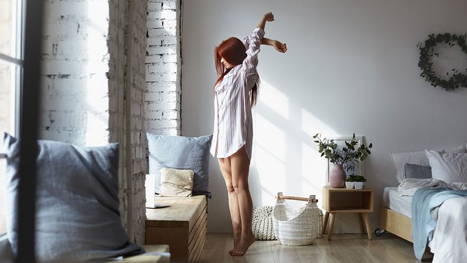 Treat Insomnia, woman stretching in the morning