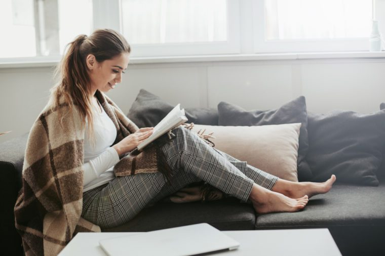 cozy woman relaxing with a book