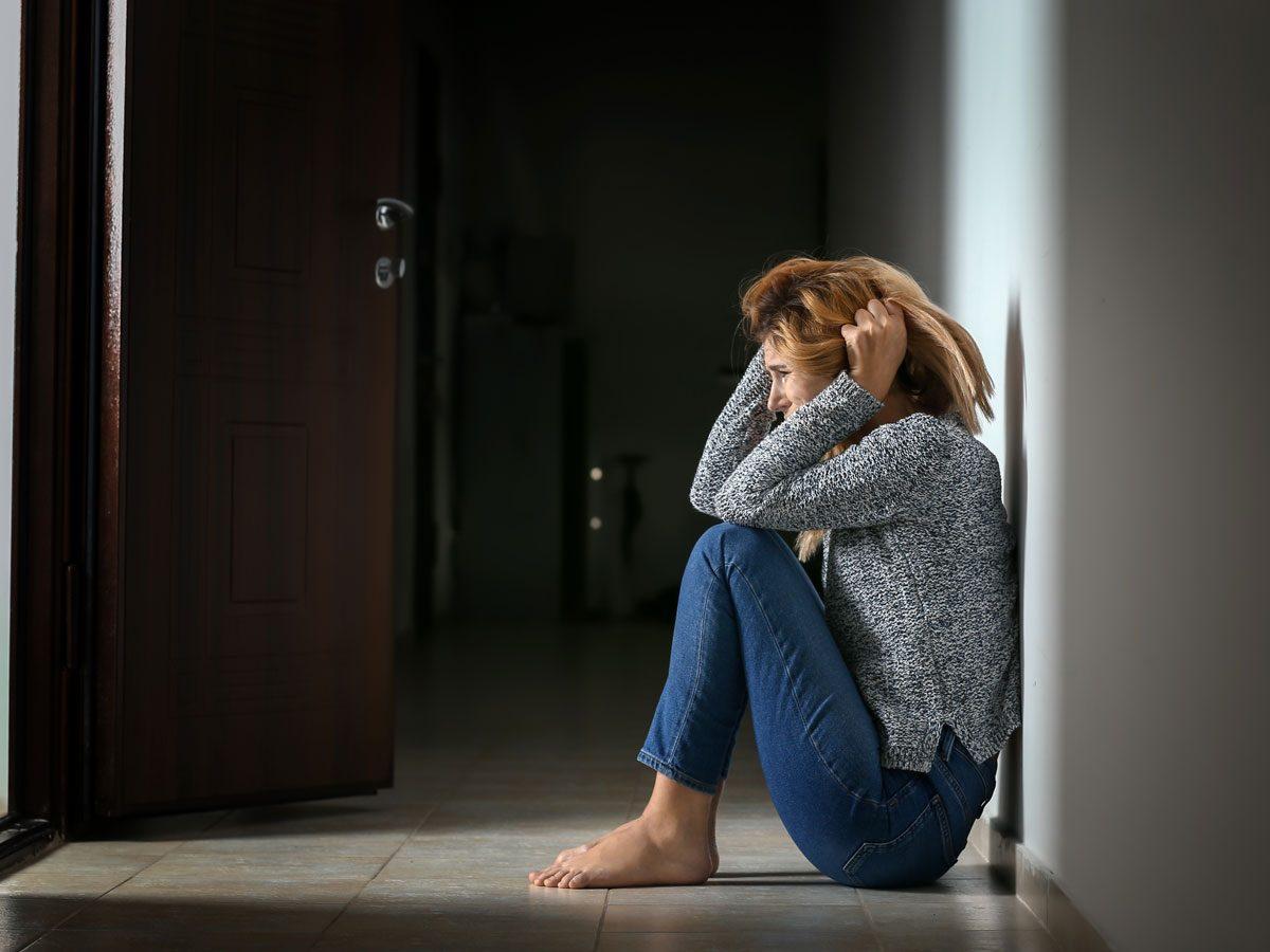 Panic Attack, woman sitting on floor