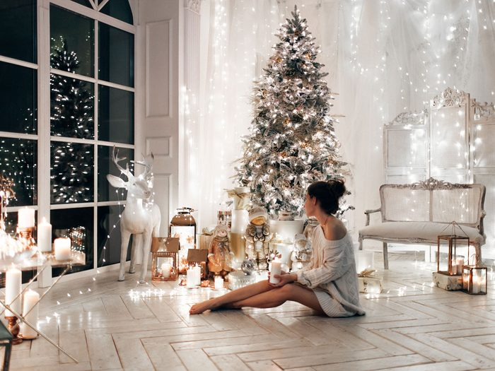 Fight Holiday Stress, woman and Christmas tree