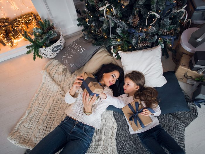 Fight Holiday Stress, mother and daughter opening presents