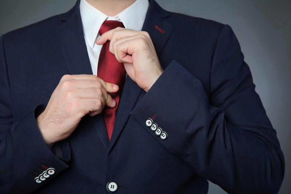 man wearing blue business suit