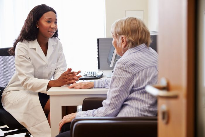 skin says about your health | Senior Patient Having Consultation With Doctor In Office