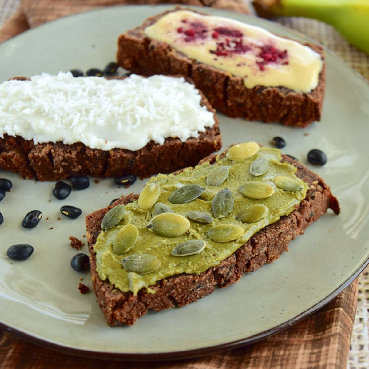 Sliced black bean bread with spread and topping