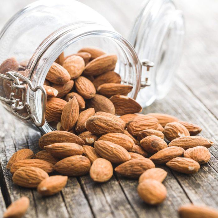 Dried almond nuts in jar.