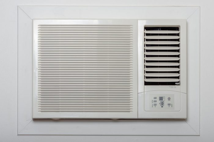 And old styled air conditioner on the wall.