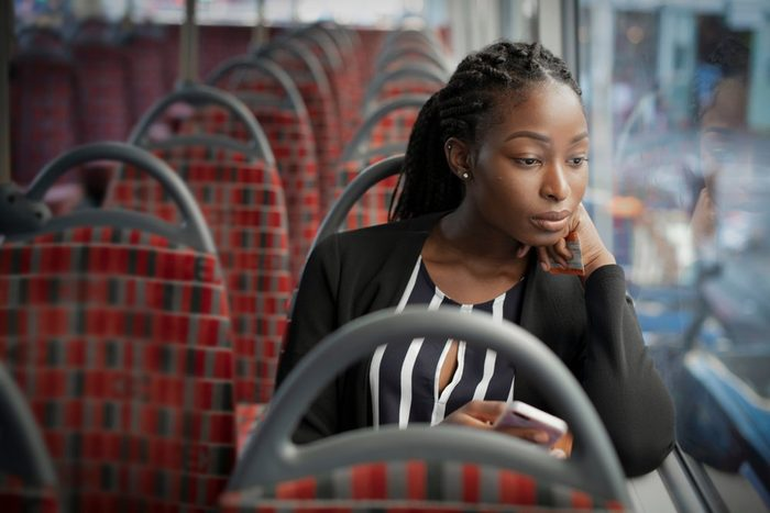 Businesswoman riding the bus to work