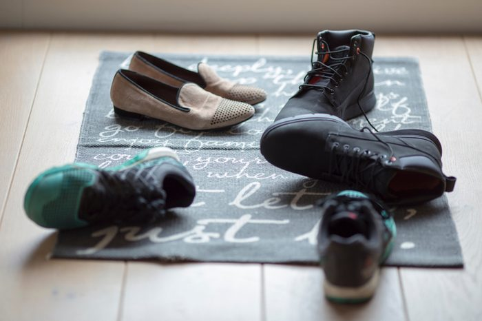 Take off our shoes when we enter the house. Some do it neatly and some don't.