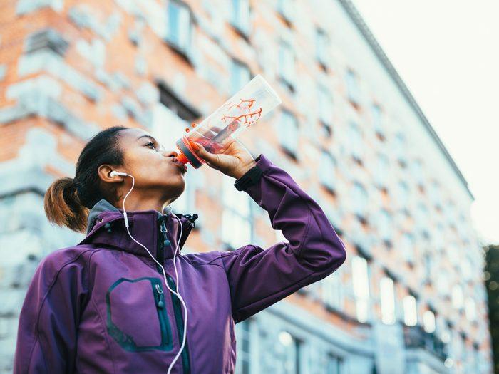 woman running drinking water sport