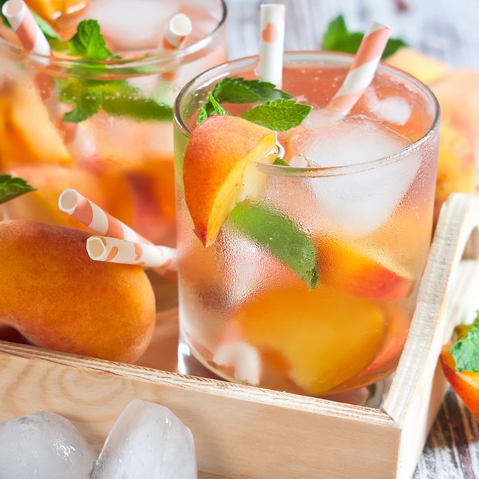 Homemade lemonade with ripe flat saturn-shaped peaches and fresh mint; Shutterstock ID 287555657; Job (TFH, TOH, RD, BNB, CWM, CM): Taste of Home