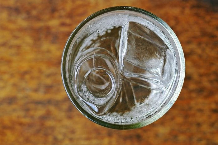 soda with water and ice in the glass cup; top view