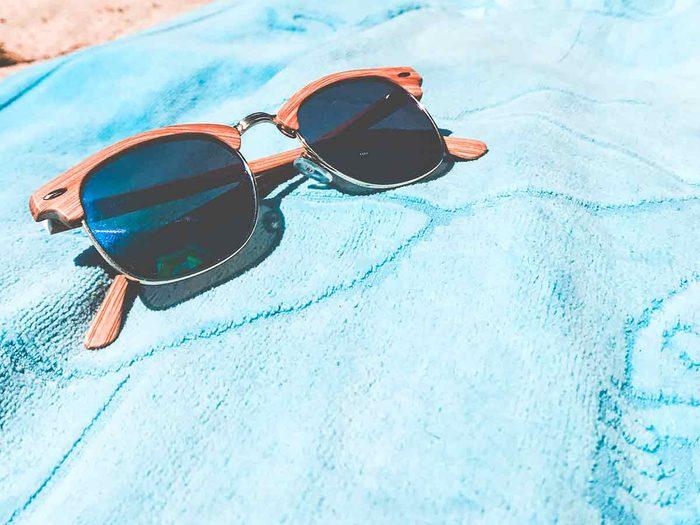 beach towel and sunglasses