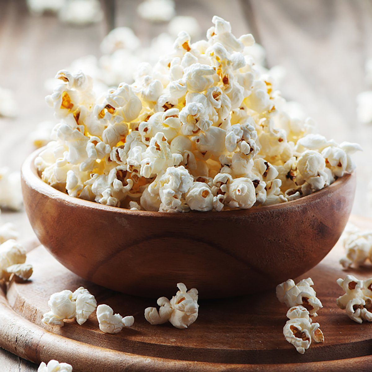 Salt popcorn on the wooden table