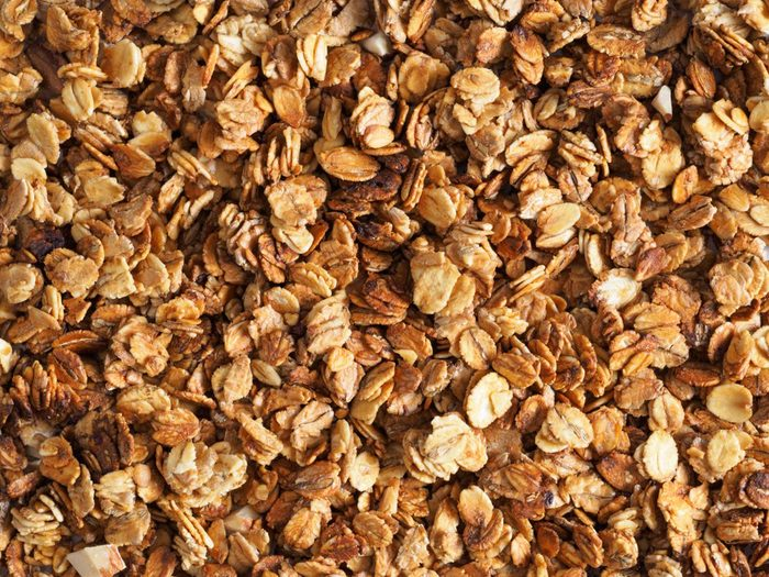 Organic homemade Granola Cereal with oats and almond. Texture oatmeal granola or muesli as background. Top view or flat-lay. Copy space for text.