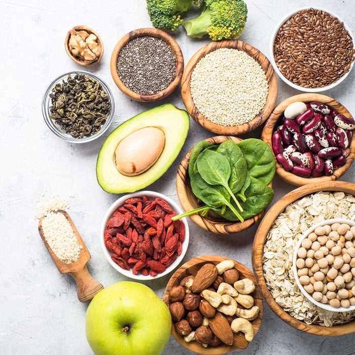 Superfoods on a gray background with copy space.