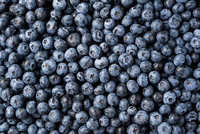 Fresh blueberry background. Texture blueberry berries top view
