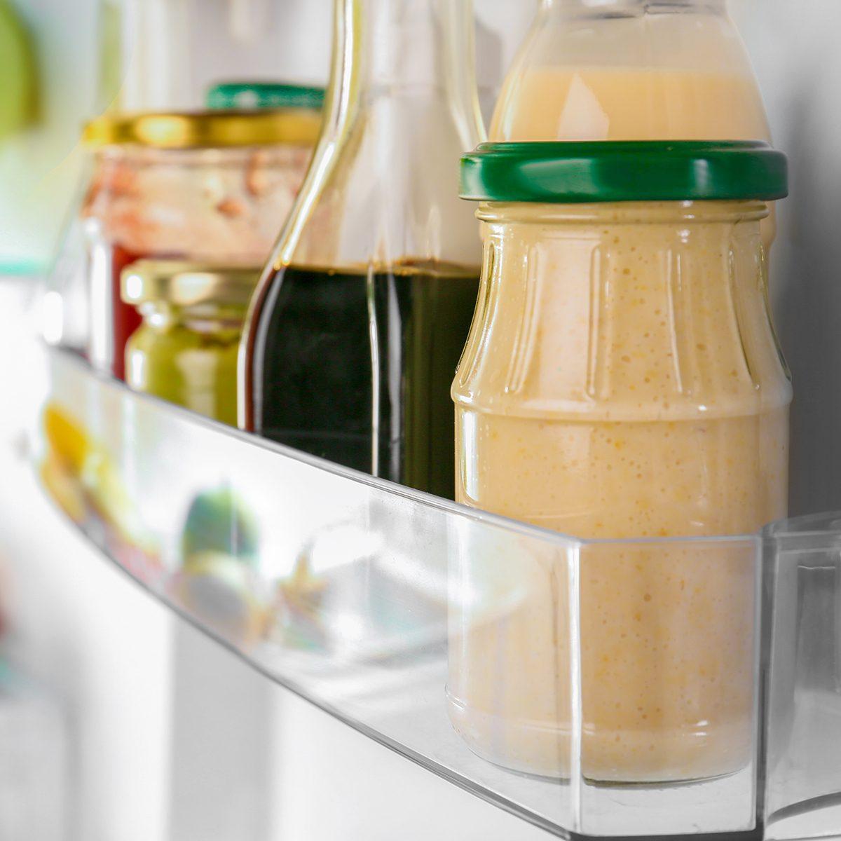 Different sauces on shelf in fridge