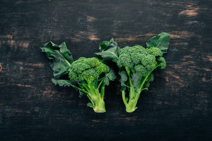 Fresh broccoli on a black wooden background. Top view. Copy space.Fresh broccoli on a black wooden background. Top view. Copy space.