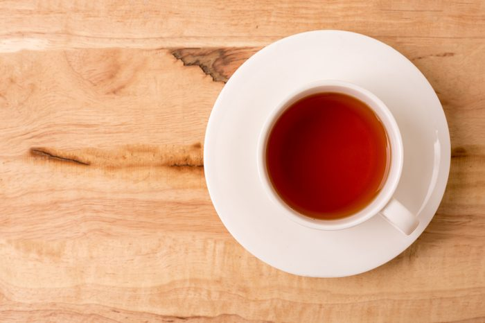 Cup of tea on a wooden tabletop.