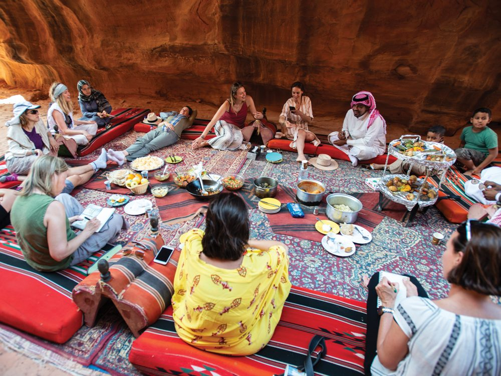 Millie - people sitting on rugs and pillows in Jordan